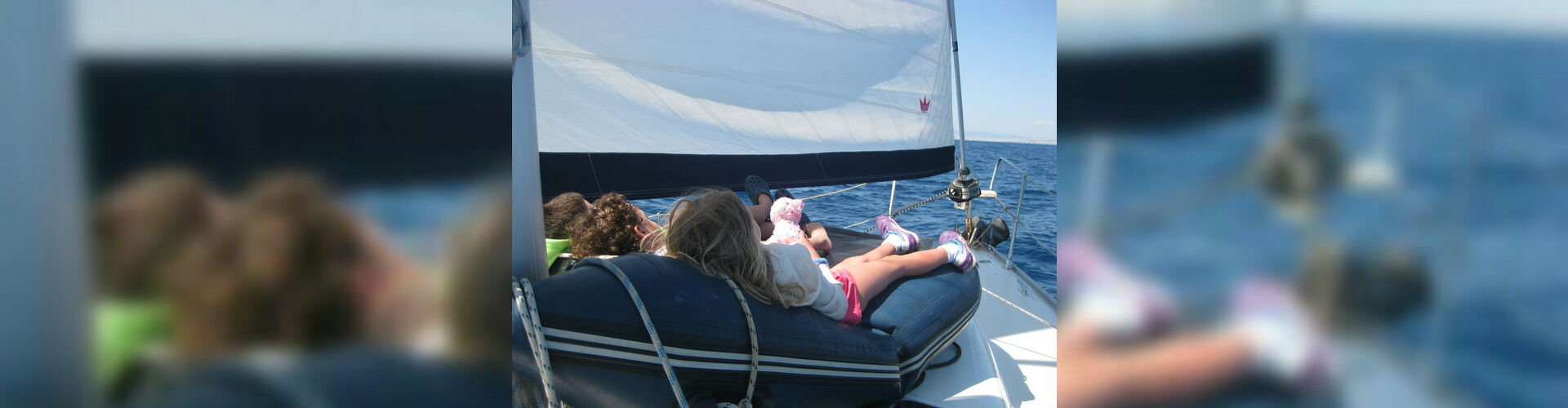 Logo sailing with children in the ionian sea