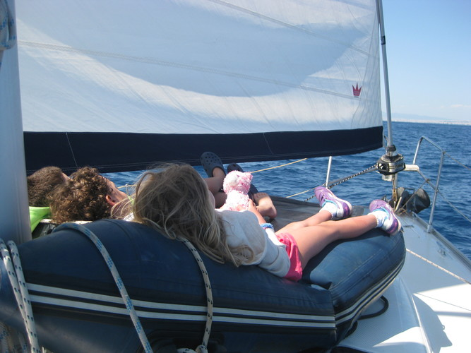 Logo s sailing with children in the ionian sea